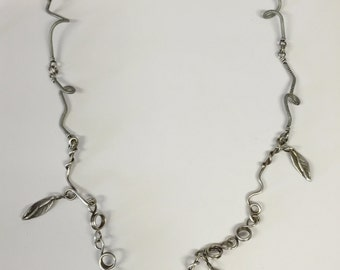 Silver Leaves hanging from spontaneous sterling silver vines of twisted and wrapped wire Necklace