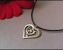 Treble & Bass Clef Heart Pendant made from brass