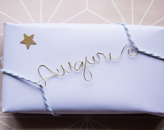 Written in wire for wrapping gifts.