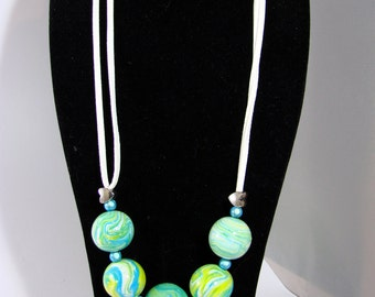Polymer clay Necklace blue and yellow, Green made hands and white suede beads broken.