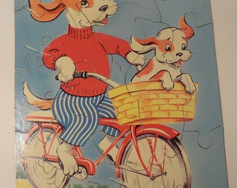 Vintage Children's Puzzle 16 Piece Dogs Riding Bicycle Bike Puppy Cardboard