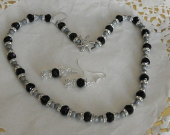 adornment in glass beads has black faceted 10 mm with silver beads and Crystal washers