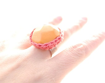Pumpkin orange ring with soft coral pink crochet trim. Fiber art ring. Adjustable wide band easily fits 7-10. Chunky Cocktail ring.