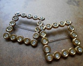 pair of circle jewel tone rhinestone brooches - silver metal with c clasp - vintage rhinestone jewelry