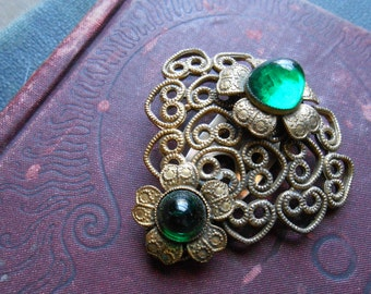 brass filigree art deco emerald green stone dress clip fur clip  - costume jewelry 1940s