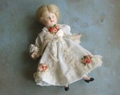Vintage Composition Bisque Jointed Doll with Wig and White Dress