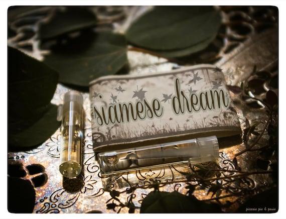 siamese dream - natural perfume oil mini sampler twin pack- primary notes: allspice, coconut, vanilla and tonka
