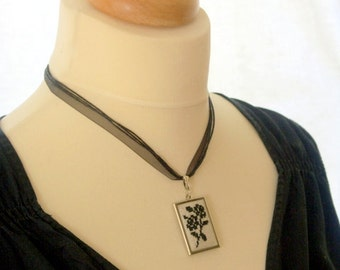 embroidered cross stitch pendant with black rose