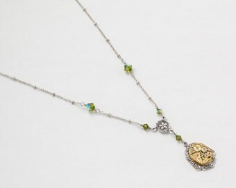 Steampunk Necklace Vintage gold watch movement with peridot green Swarovski crystal beads Victorian styled silver flower Statement necklace