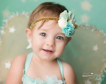 French Connection- aqua mint and gold headband with ,ruffle  rosettes, chiffon flowers  netting and feather