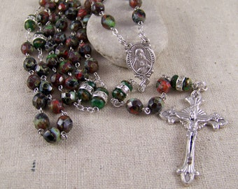 Catholic rosary in red, green and black faceted picasso beads