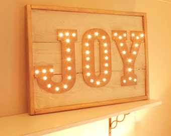 Gold and White JOY Marquee Sign