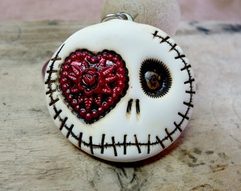 White round happy skull with a huge red heart in his eye. Creepy Valentine! Booch, Fridge magnet, Keychain, Pendant