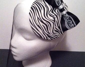 Fancy black & white zebra fascinator hat. Portion of sale goes to charity.