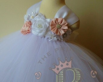 White flower girl dress with a mixture of vintage pink and white flowers. Tutu dress