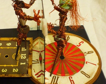 Lovers Out of Time, tragic copper wire and found object sculpture, rustic romance, Dr. Who distance relationship