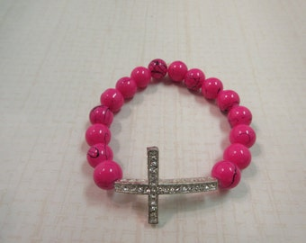Rose splattered beaded bracelet  with silver sideway cross.