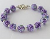 Artisan bracelet, Purple  Bracelet, Purple rose bracelet, Butterfly, Handmade, unique, Bracelet, Polymer clay bracelet, Artisan jewelry.