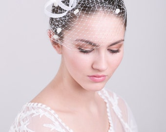 Bridal fascinator with dotted birdcage, wedding millinery hairpiece, feather headpiece