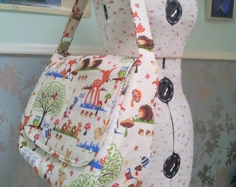 Made to order - Large baby bag with multiple pockets and outer zip fastening.