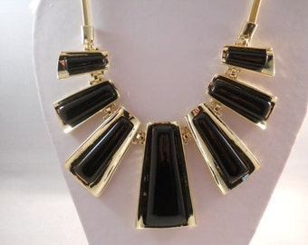 Bib Necklace with Gold Tone and Black Pendants on a Gold Tone Chain