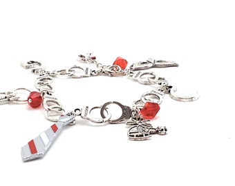 Fifty shades of Grey charms bracelet on cuffs whit red tie