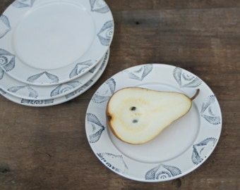4 appetizer plates with antiqued print in charcoal and white