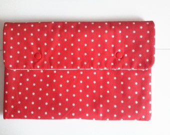 Red cover for shelves with polka dots