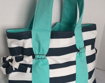 Large Diaper bag, purse, handbag navy blue and white stripe with aqua straps and lining. Front key pocket and options of bottle pockets.