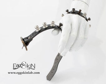 Fundor is a black leather band with round studs.