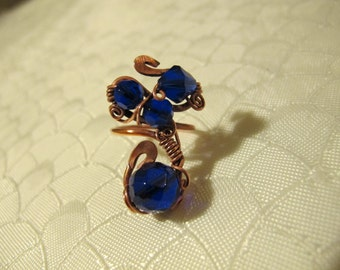 Blue Ring. Handmade Ring set with Beautiful Deep Blue Glass Beads. Copper Wire Wrapped Ring. Unique Design. Spiral Wiring.