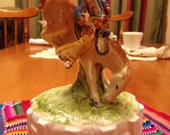 Pretty Cowgirl Riding a Bucking Bronco Music Box