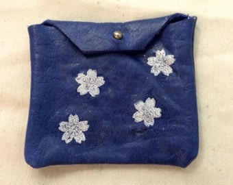 Blue leather pouch with white printed cherry blossoms