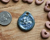 Handmade ceramic porcelain clay pendant,blue gloss glaze over medieval griffin,handmade bead supply,unisex jewelry,available as necklace