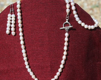 Pearl necklace, earrings, and bracelet set