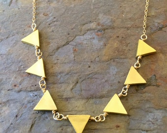 Gold statement necklace with triangle charms
