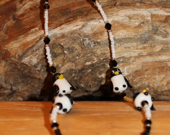 Lampwork penquin necklace with black and white seed beads.