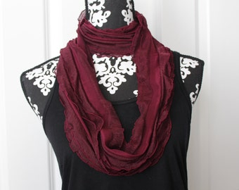 Burgundy colored ruffle knit infinity scarf! Fun and lightweight! Great scarf for any season! Travels well! Beautiful burgundy red color!