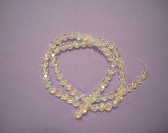 clear AB glass beads, 6mm hand-faceted round. 16-inch strand.