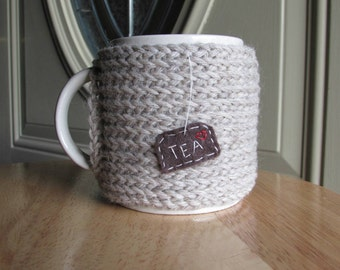 Knitted tea cup cozy mug cozy in buscuit with hand embroidered hanging tea patch