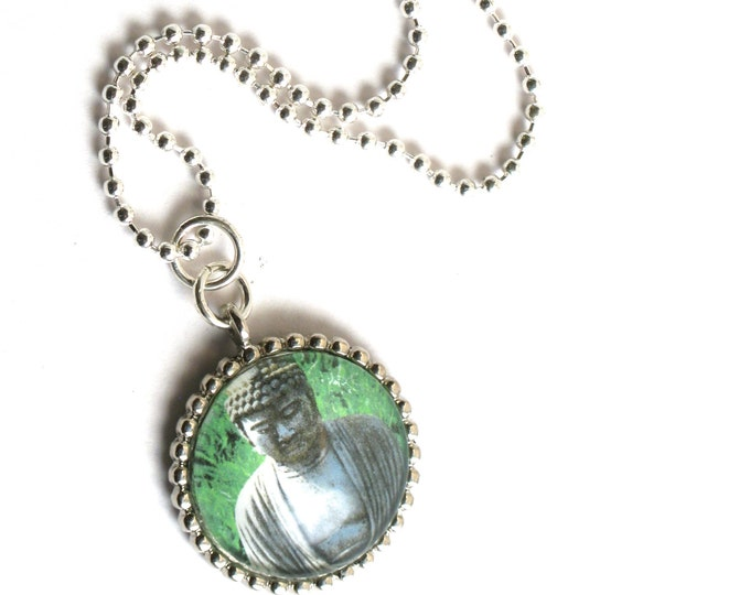 Buddha in the Green of Spring, A Round Photographic Domed Glass Cabochon in an Antique Silver Beaded Edge Pendant on a Silver Ball Chain