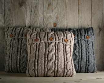 Cappuccino color cable knit pillow cover with 3 wooden buttons.