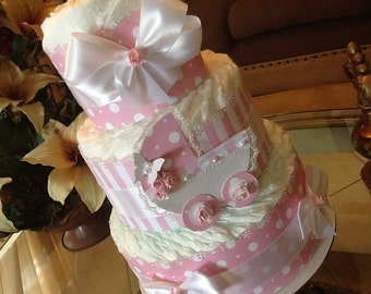 Baby girl diaper cake baby shower gift/centerpiece. Pink and white diaper cake.
