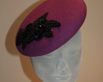 Purple felt beret with beaded embellishment