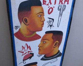 Teaches African barber hairdresser
