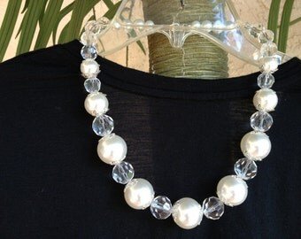 The big crystal and white pearl necklace