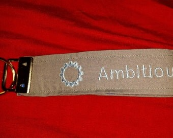 "Top Gear inspired ""Ambitious but rubbish"" wristlet keychain"