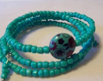 Torquoise E Bead Memory Wire Bracelet With Torquoise Floral Bead