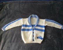hand knitted cream and pale blue baseball jacket