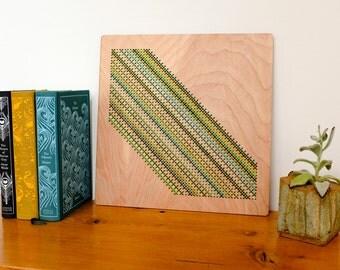 "Modern Cross Stitch, Laser Cut Birch Wall Hanging, 12"" x 12"", Slash Pattern, Greens and Golds"